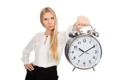 Affärskvinna med den isolerade klockan Fotografering för Bildbyråer