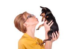 Affärskvinna med den lilla hunden Arkivfoton