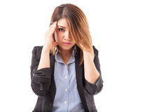 Affärskvinna med en huvudvärk royaltyfri foto