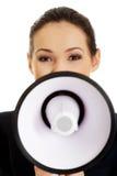 Affärskvinna med en megafon Fotografering för Bildbyråer
