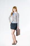 Affärskvinna med en portfölj Royaltyfri Fotografi