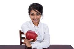 Affärskvinna med ett äpple Royaltyfri Fotografi