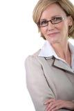 Affärskvinna med exponeringsglas Arkivbild