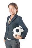 Affärskvinna med fotboll Royaltyfri Foto