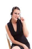 Affärskvinna med hörlurar med mikrofon Royaltyfri Foto