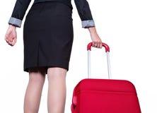 Affärskvinna med handbagage Fotografering för Bildbyråer