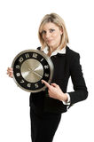 Affärskvinna med klockan Arkivbild