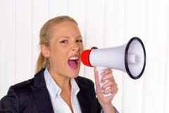 Affärskvinna med megafonen royaltyfria foton