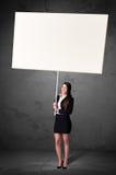 Affärskvinna med tom whiteboard Royaltyfria Foton