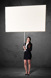 Affärskvinna med tom whiteboard Royaltyfri Foto