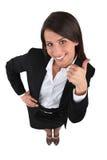Affärskvinna med tummar upp Fotografering för Bildbyråer