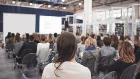 Affärskvinna och folk som lyssnar på konferensen Se mer i min portfölj Royaltyfria Bilder