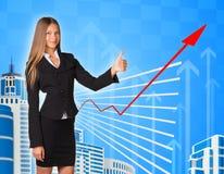 Affärskvinna och grafiskt diagram arkivfoton