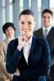 Affärskvinna och lag Arkivfoton