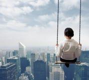 Affärskvinna på en swing Arkivbilder