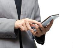 Affärskvinna som använder en smart telefon Arkivbild