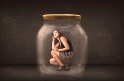 Affärskvinna som fångas i ett glass krusbegrepp Fotografering för Bildbyråer
