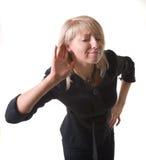 affärskvinna som lyssnar Arkivbilder