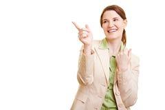 affärskvinna som pekar till vänster till Arkivbilder