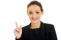 affärskvinna som pekar upp Royaltyfri Bild