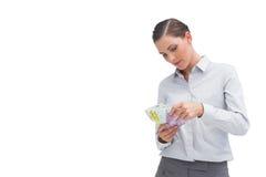 Affärskvinna som räknar hennes pengar Fotografering för Bildbyråer