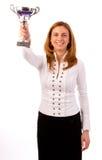 Affärskvinna som segrar en trofé Royaltyfri Fotografi
