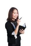 Affärskvinna som skriver och ler som är lycklig på vit bakgrund Royaltyfri Bild