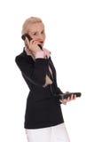 Affärskvinna som talar på en gammal telefon Royaltyfri Bild