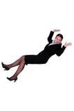 Affärskvinna som tillbaka faller arkivfoto