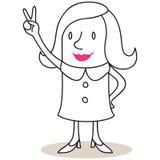 Affärskvinna som visar det segerrika handtecknet Fotografering för Bildbyråer