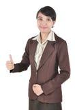 affärskvinna som visar upp tumen Arkivfoto