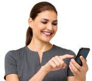 Affärskvinna Touching Smart Phone Arkivbild
