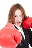 Affärskvinnaboxning som stansar in mot och, ordnar till för att slåss Royaltyfria Foton
