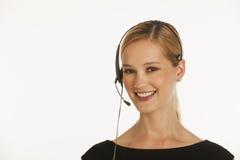 affärskvinnahörlurar med mikrofon Arkivfoto