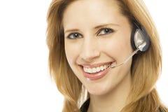 affärskvinnahörlurar med mikrofonbruk Arkivbilder
