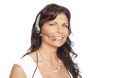 affärskvinnahörlurar med mikrofonslitage Arkivfoto
