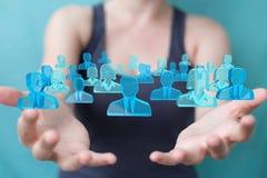 Affärskvinnainnehav och trycka på gruppen för tolkning 3D av blå pe Arkivfoto