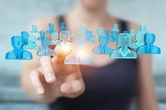 Affärskvinnainnehav och trycka på gruppen för tolkning 3D av blå pe Fotografering för Bildbyråer