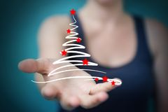 Affärskvinnainnehavet och rörande julträd skissar Fotografering för Bildbyråer