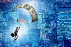 Affärskvinnan i guld- hoppa fallskärm begrepp Arkivfoton