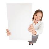 Affärskvinnan med tomt undertecknar upphetsad Arkivfoton