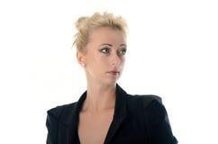 Affärskvinnan ser höger sida som isoleras Arkivbild
