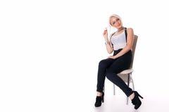 Affärskvinnan sitter på en stol Arkivfoton