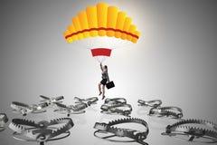 Affärskvinnan som faller in i fälla hoppa fallskärm på Royaltyfri Foto