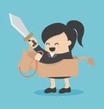 Affärskvinnan som rider leksakhästen, har svärdet Arkivfoton