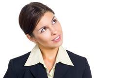 Affärskvinnan som ser upp och, l5At vara Arkivfoto