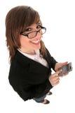 affärskvinnaräknemaskinholding arkivfoto