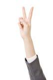 Affärskvinnas hand med segergest royaltyfria foton