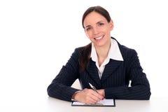 affärskvinnaskrivbordsitting royaltyfria bilder