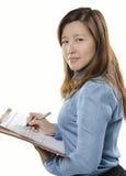 Affärskvinnawritinganmärkning Royaltyfri Foto